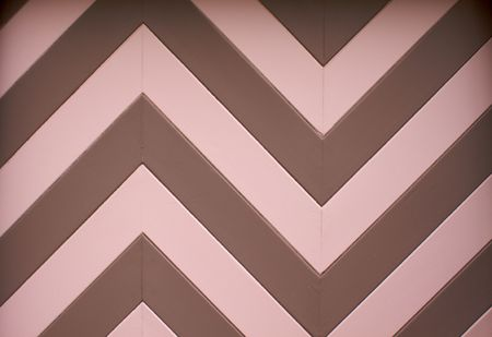 a chevron or zig zag wood design of a garage door on an older home photo