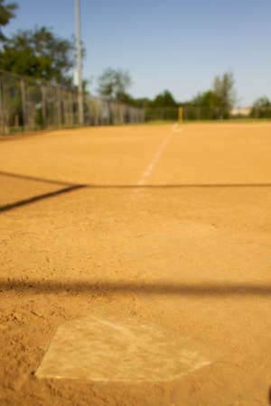 short depth of field shot of home plate looking towards third base photo
