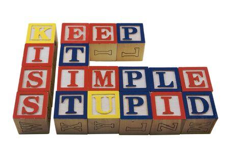 the simple: Wood Alphabet blocks spelling KISS Keep it simple stupid
