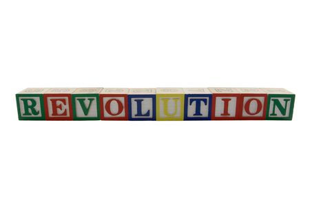 Wood Alphabet blocks spelling Revolution Banco de Imagens