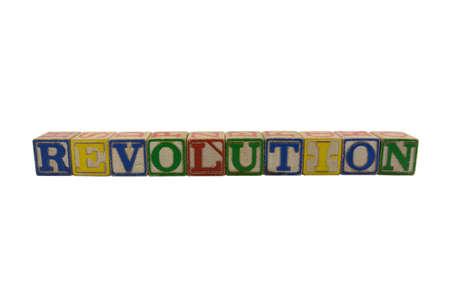 Vintage Wood Alphabet blocks spelling Revolution Stock Photo