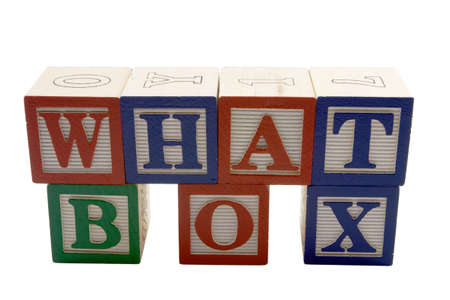 Wood Alphabet blocks spelling What Box Stock Photo