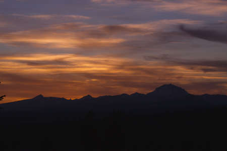 Sunset at Lassen Park with Mountain silhouetted against sky photo