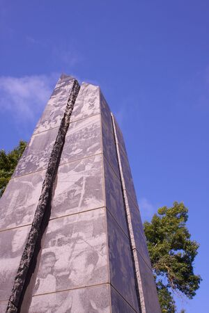 California State Park Veterans Memorial obelisk framed by trees and sky