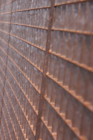 Brown metal grid fence in perspective Stock Photo - 5139035