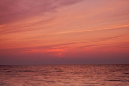 Summer evening sunset over lake Michgan with calm waters