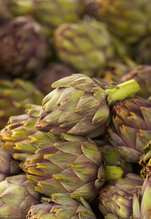 Pile of Artichokes Vertical at the farmers market