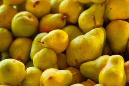 Pile of yellow Bartlett Pears for sale at the farmers market
