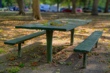 Green Park Picnic Bench done in high dynamic range HDR with soft focus background photo