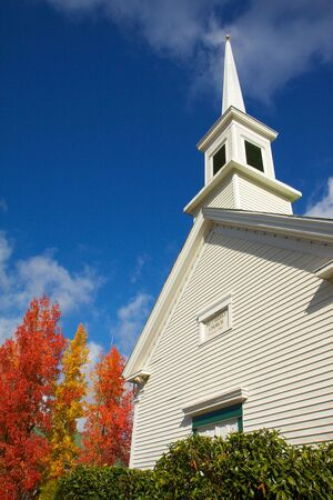 Old Steepled Chruch next to trees turning to fall colors Stock Photo - 5883433