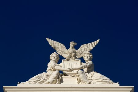 California State Capitol sculpture of two women or girls holding hands across the US shield with an eagle above Banco de Imagens