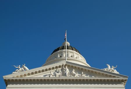 Closeup of California state capitol building sculptures of Minerva, the dome, and the two horses photo