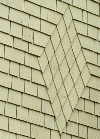 Diamond pattern of Green wood shingles on a bungelow house Stock Photo - 6100580