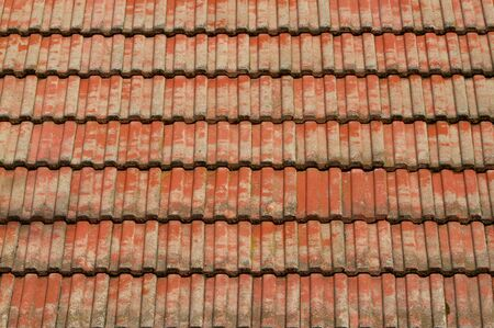 Faded corrugated red tile roof in the sun Stock Photo - 6359567