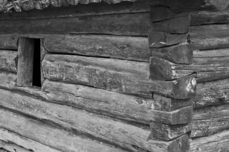 Small log cabin with open window close up done in black and white Stock Photo - 6476140