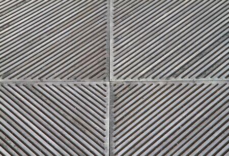 sidewalk steel grating with mezmerizing pattern of holes photo