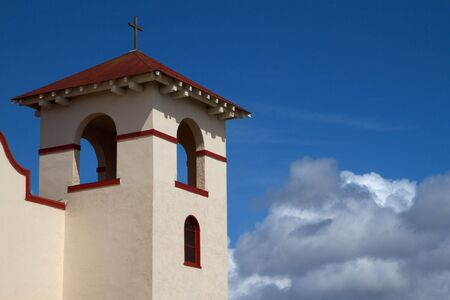 Fort Bragg Mission Church bell tower against partly cloudy blue sky photo