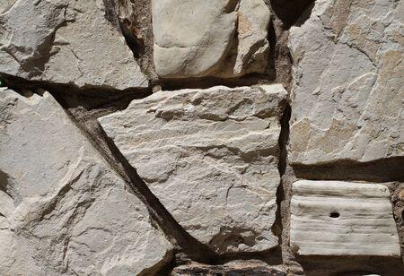 Six rocks sun lit on a stone wall Stock Photo - 7000330