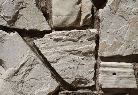 Six rocks sun lit on a stone wall Stock Photo - 7000330