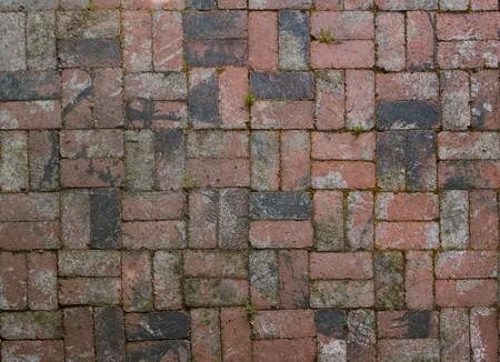 Old factory brick used in alternating pattern patio floor