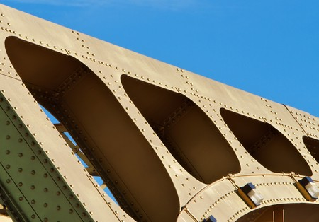 girders: Old style Gold painted steel beam and girders in an abstract view of Sacramento Tower Bridge
