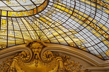 stained glass windows: Gold colored stained glass windows as part of a domed ceiling