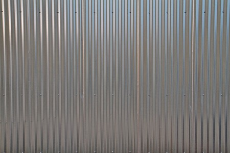 Close up of a shiny corregated steel wall photo