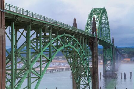 repetitious: Old green metal bridge disappearing into the mist as HDR image