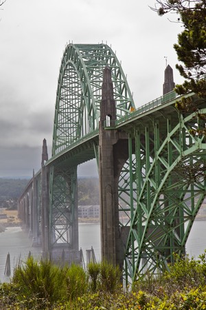 repetitious: Old green metal bridge disappearing into the mist