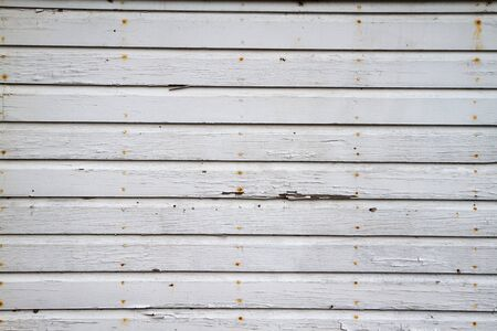 white wood floor: Blue Gray Weathered Wall with cracked paint and rusty nails Stock Photo