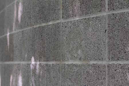 Curved gray close up of a concrete block wall photo