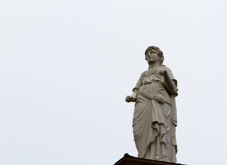 Courthouse statue of Themis Goddes of Justice missing sword and balance photo