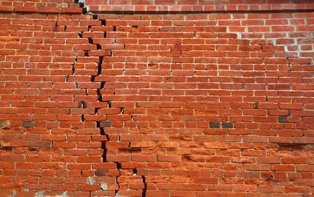 Large crack of separating bricks in a red wall Stock Photo - 7742041