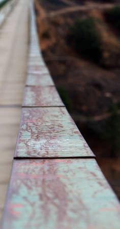gaurd: Road and pedestrian walk on bridge with green metal gaurd rails Stock Photo