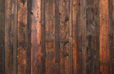 Old dark red and brown stained wood wall photo