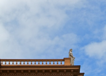Courthouse statue of Themis Goddes of Justice standing on the edge of a roof Stock Photo - 7742035