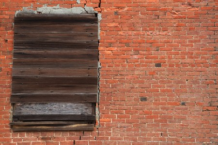 Old brick wall with weathered wood boarded window Stock Photo - 7742091
