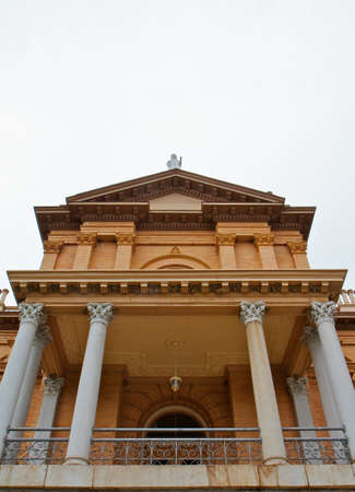 Front facade of pillared tan brick courthouse with statue on top Stock Photo - 7742074