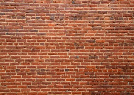 brick: Old dirty multi shaded red brick wall