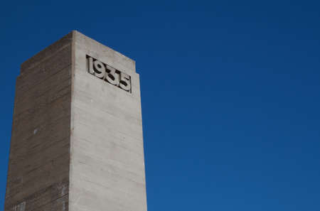 artdeco: Deco concrete tower with 1935 engraved against a dark blue sky