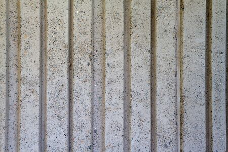 Gray Deep wide vertical grooved concrete wall