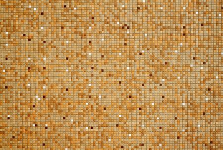 Sun lit wall with tan brown white mosaic tiles photo