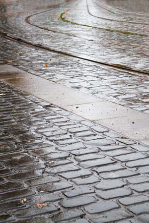 imbedded: Wet brick road with imbedded train track in Portland Oregon Stock Photo