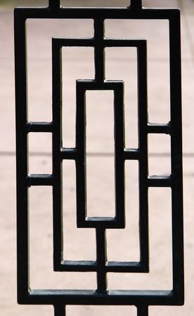 black, near silhouette, of a portion of a deco designed wrought iron gate Zdjęcie Seryjne