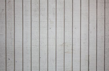 Section of a dirty white  grooved wood wall photo