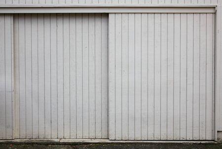 Old style Sliding beige painted wood garage doors photo