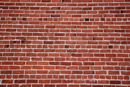 Different shades of ready and a changing pattern red brick wall Stockfoto