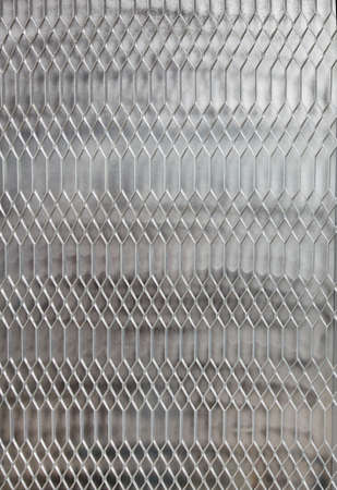 lattice window: Metal barred or grated security installed on a window Stock Photo