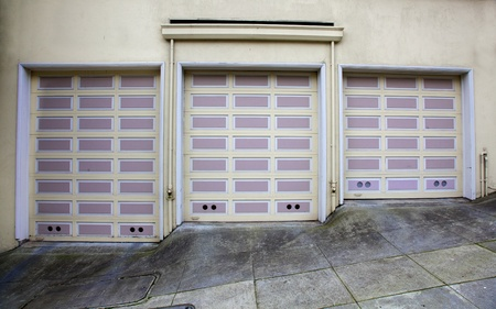 Three lavender and beige garage doors on a hill in San Francisco Stock Photo - 8624181