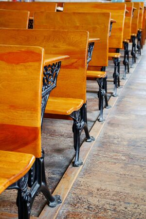 Row of  wood and metal desks at a an old school house in Sacramento photo